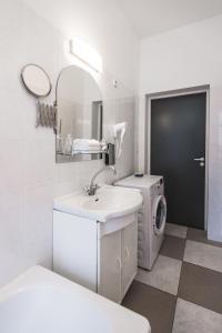 Vannas istaba naktsmītnē Bearsleys Archers Apartments