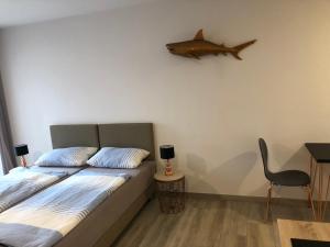 Cama o camas de una habitación en LuxApartments