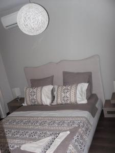 A bed or beds in a room at VIP Apartaments Galina