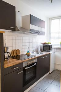 A kitchen or kitchenette at Appartementhaus Obertrave