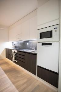 A kitchen or kitchenette at Residence Eliel