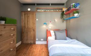 A bed or beds in a room at Artistic and Soulful Carnaby Street Movie Pad
