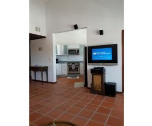 A television and/or entertainment center at Beautiful Villa at The Rio Mar Beach Resort
