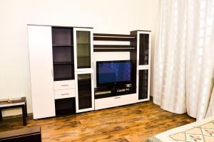 Телевизор и/или развлекательный центр в W Apartament Leningradskoye 10