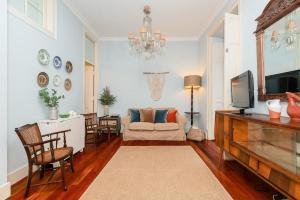 A seating area at Charming 3 bedroom apartment at Anjos