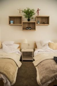 A bed or beds in a room at Diamond Residence - BimBam Bajza