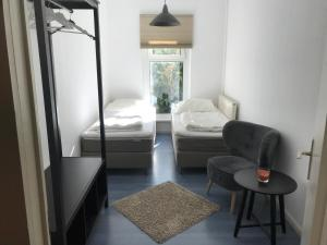 A bed or beds in a room at eastside1