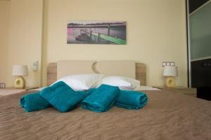 A bed or beds in a room at Athens Airport View