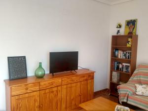 A television and/or entertainment center at Playa Paraiso 28E