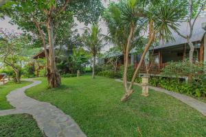 A garden outside Villa D'Carik Bali