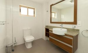 A bathroom at Sahaj Holiday Apartments