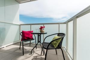 A balcony or terrace at P&O Apartments EXPO XXI