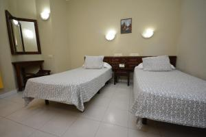 A bed or beds in a room at Aparthotel Las Lanzas