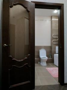 A bathroom at Comfortable Apartment in the Center