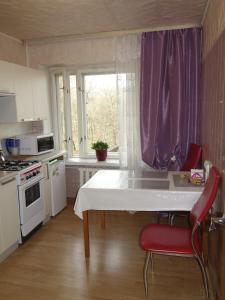 A kitchen or kitchenette at Apartment on Nikolskaya