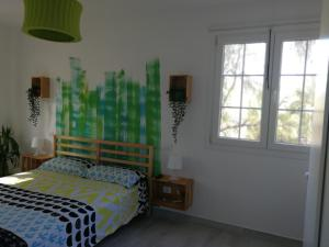 A bed or beds in a room at TRANQUILIDAD, MAR Y SOL!