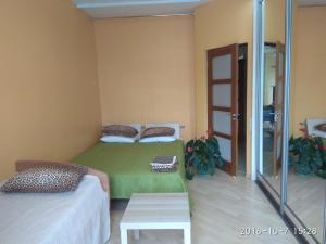 A bed or beds in a room at Apartment on Lenina boulevard