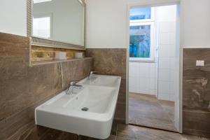 Ein Badezimmer in der Unterkunft RiSo Apartment 2