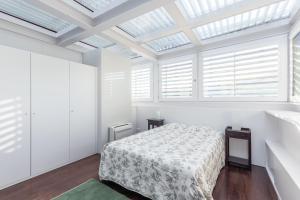 A bed or beds in a room at Casa de Vilar, Parque Natural Peneda Gerês