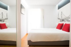 Uma cama ou camas num quarto em Páteo Saudade Lofts