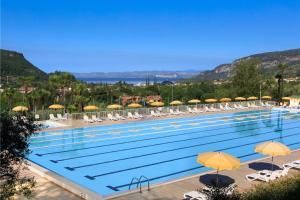 The swimming pool at or near Poiano Garda Resort Appartamenti