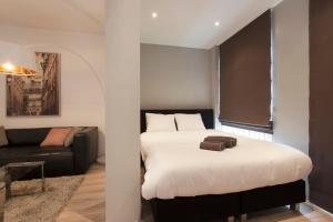 A bed or beds in a room at Luxury Amsterdam City Center Apartments