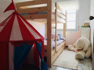 A bunk bed or bunk beds in a room at La Casona de Coquina