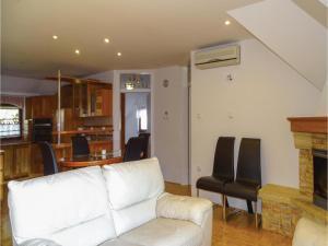 Predel za sedenje v nastanitvi Two-Bedroom Apartment in Zrece