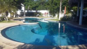 The swimming pool at or near Casa Privadas Cuyagua 69