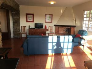 A television and/or entertainment center at Funchal Apartment in Tourist Area with Ocean View