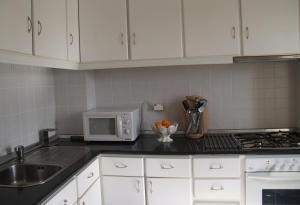 A kitchen or kitchenette at Moinho das Eiras