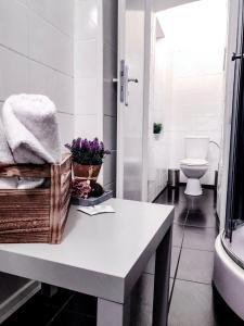 Ванная комната в Avocado Apartment