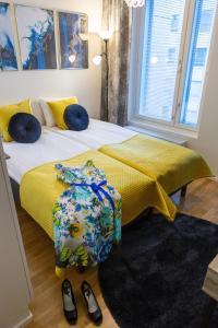 Un ou plusieurs lits dans un hébergement de l'établissement Antintorni Apartment 14
