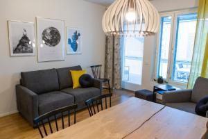 Coin salon dans l'établissement Antintorni Apartment 14