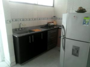 Una cocina o zona de cocina en Apartamento Doña Nelly