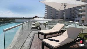 The swimming pool at or near Suites Malecon Cancun
