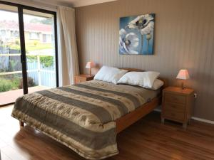 A bed or beds in a room at lake and ocean view