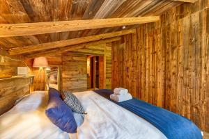 A bed or beds in a room at Chalet Higamel