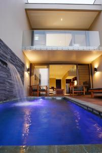 The swimming pool at or near The Terraces Boutique Apartments