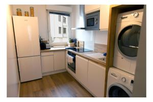 A kitchen or kitchenette at Cosy appart 80m2 hyper centre/vieux Lille