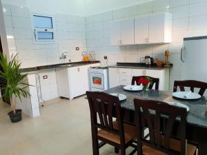 A kitchen or kitchenette at Marhaba Guest House