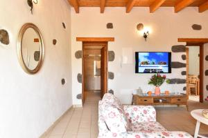 A television and/or entertainment center at Los Algodones Cottage with Pool