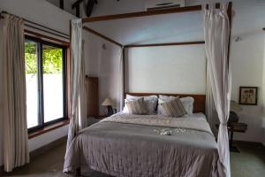 A bed or beds in a room at SaffronStays Beyond