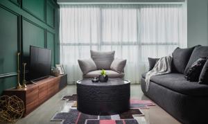 OYO Home 916 Elegant 2BR Arte Plusにあるシーティングエリア