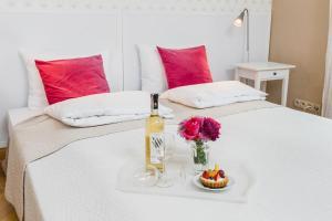 Lova arba lovos apgyvendinimo įstaigoje Apartamenty w Pałacu Pod Baranami