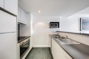 A kitchen or kitchenette at Adina Apartment Hotel Wollongong