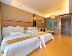Кровать или кровати в номере Beijing Yongli International Service Apartment