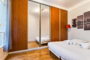 A bed or beds in a room at CMG Parc des Princes/ Exelmans