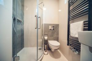 Ванная комната в Royal apartment with balcony