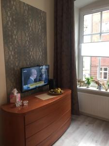 A television and/or entertainment center at Apartament Vanilla Sky Wroclaw